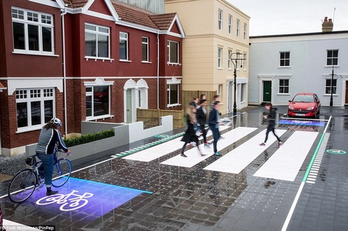 The patchwork of LED panels are completely waterproof. They could also be adapted into pressure pads to identify if a person or vehicle is treading on them, experts behind the creation told This is Money