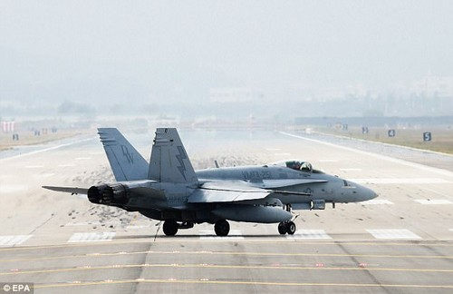 The South Korean military said this was part of a regular exercise to bolster military defences and also to display the alliance between the United States and South Korea. Pictured: An F/A-18 fighter atOsan Air Base, south of Seoul, South Korea, yesterday