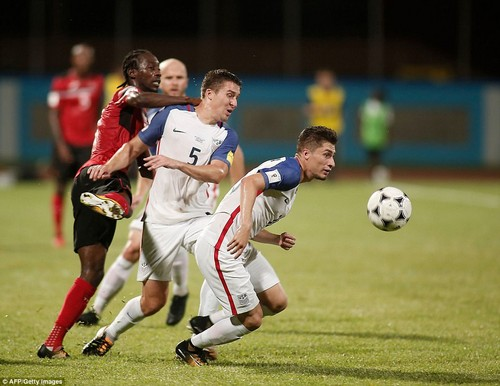 USA's Matt Besler (C) and USA's Jorge Villafana (R) vie for the ball with Trinidad and Tobago's Nathan Lewis (L) during their 2018 World Cup qualifierOctober 10, 2017