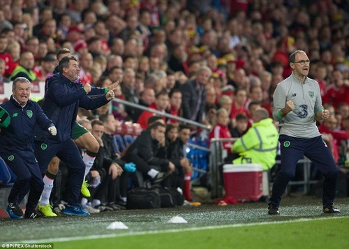 Republic of Ireland boss Martin O'Neill and assistant Roy Keane leap in joy after McClean's superb strike for the visitors