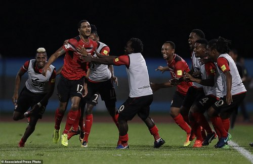 Trinidad and Tobago's Alvin Jones (17) celebrates with his teammates after scoring against U.S. during a World Cup qualifying soccer match in Couva, Trinidad, Tuesday, Oct. 10, 2017