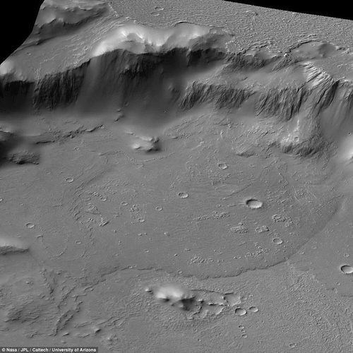 The images even reveal a circular flow of now-dried molten lava (pictured) at the base of the feature. The lava once billowed and fanned outward from the crater's floor