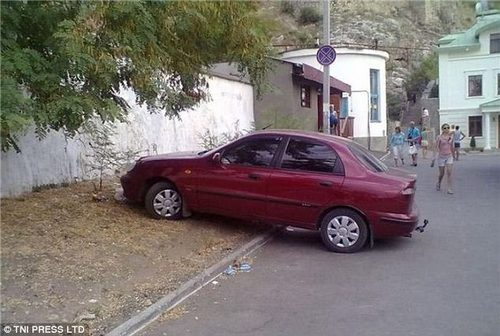 This driver meanwhile ignored the no stopping sign, before mounting their car onto the curb