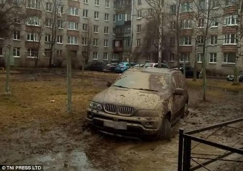 One motorist was left with a filthy car while parking in the middle of a muddy patch of grass