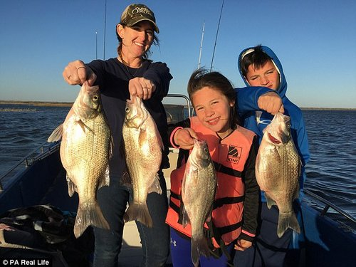Heather, with Armonia and Isa pictured out fishing, believes that hunting keeps kids off their mobile phones
