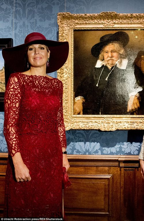Pretty as a picture: Maxima poses with artwork that will be touring around for the exhibition