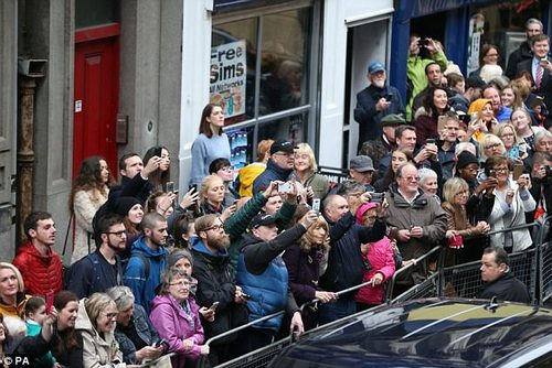 The crowd cheer the arrival of the Duke of Cambridge for his visit to Inspire