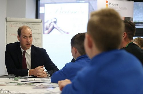 The Duke of Cambridge talks to some youth Northern Ireland footballers about mental health in sport