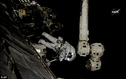 Spacewalking astronauts worked at giving the International Space Station's big robot arm a new hand Thursday. Astronaut Mark Vande Hei can be seen working on the International Space Station