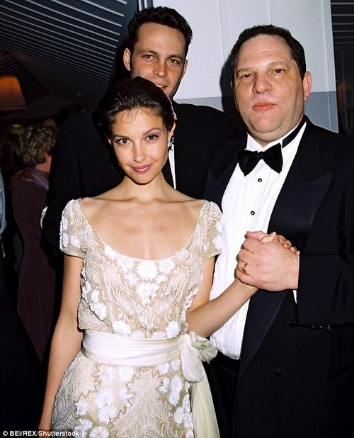 Hands were my eyes can see:Ashley Judd posed for a photo with Harvey Weinstein and Vince Vaughn at a 1997 Oscars party (above), just months after he sexually harassed her at his hotel
