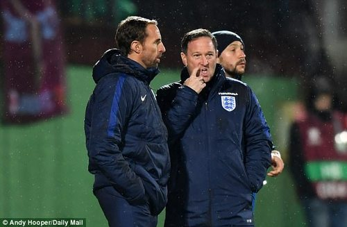 Steve Holland (right) likes to keep a low profile as Gareth Southgate's England assistant boss