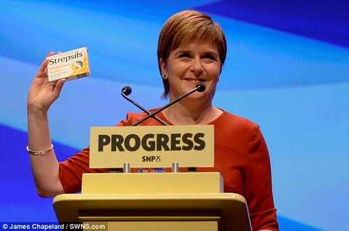 Nicola Sturgeon ridiculed Theresa May's disastrous conference speech today as she appeared in front of delegates with a box of Strepsils