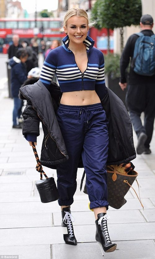 Teetering:Tallia donned a somewhat impractical and rather bizarre outfit as she tottered to a boxing class at a London gym on Tuesday