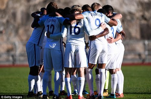 England's players enter a huddle ahead of their Group 4 match against Andorra