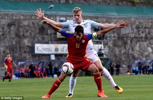 Andorra's Aleix Viladot holds off Joseph Worrall during the first half
