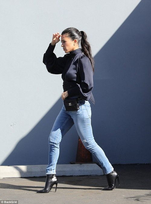 Perfectly accessorized:Kourtney teamed her clothes with high heeled black booties and a tiny Chanel purse