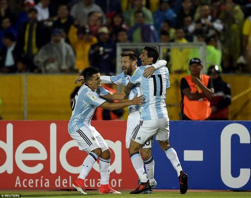 Di Maria and Marco Acuna celebrate with the forward after he put them back on track to qualify for the 2018 World Cup