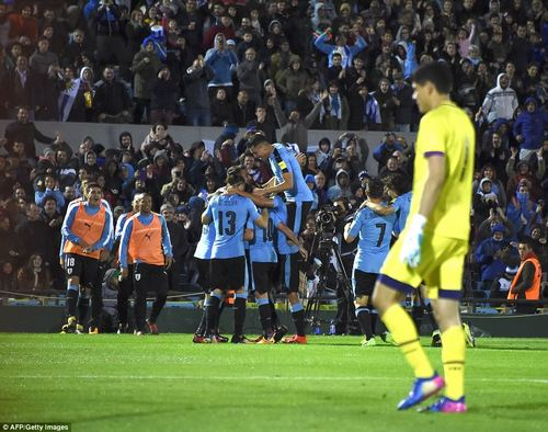 The Uruguay side come together to celebrate their fourth goal with World Cup qualification a certainty