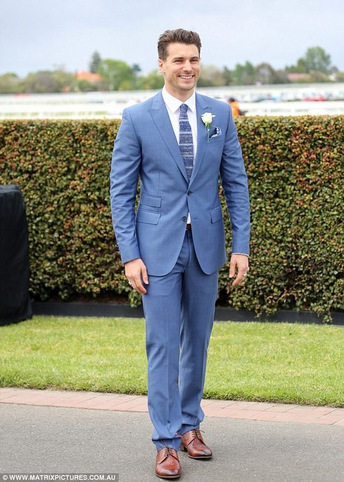 Dapper:Matty was dressed sharply for the race day, wearing a fitted blue suit with a matching suit and tie