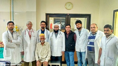 Dr Mohammad Haneef Beg (third from left), head of the university's cardiovascular and thoracic surgery department, led the procedure to remove the mass from Mr Arya (front)