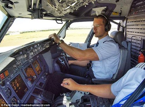 At the helm: The good-looking aviation expert prepares for take-off on another flight