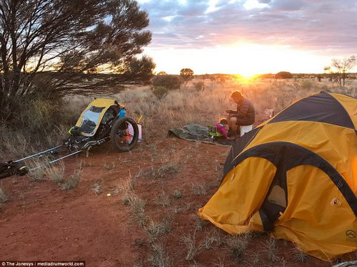 Sunset: After another busy day clocking-up the miles, Justin and Morgan enjoy their evening meal in the open air