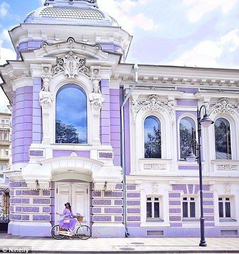 Nina blends into a lilac building on Pyatnitskaya Street in Moscow