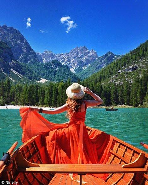 Nina seen bobbing along on a boat atLake Braies in Italy