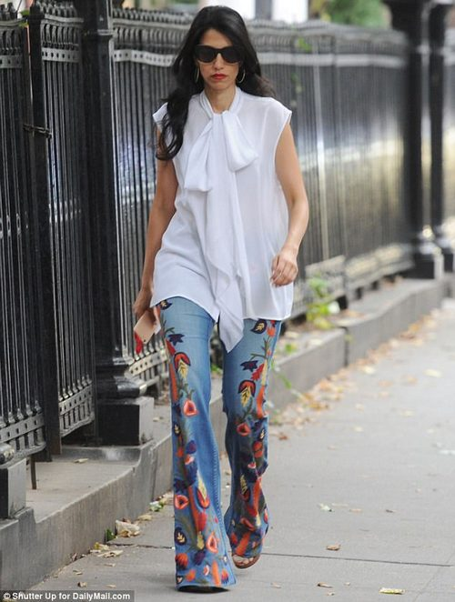 Hippie chick: The mother of one wore a pair of embroidered Alice and Olivia flared jeans for the trip, pairing the vibrant pants with a more elegant pussy bow blouse