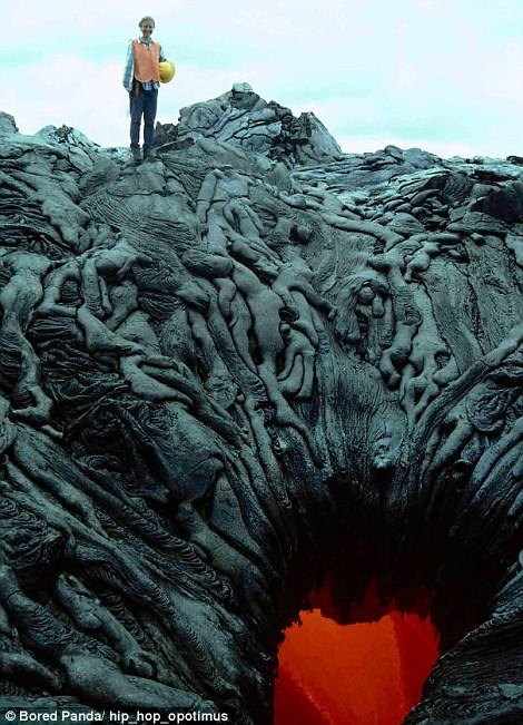 The burnt lava surrounding this volcanic pit looks like charred bodies being sucked into a fiery pit