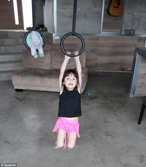 Encouraging Bella's Ninja Warrior side, her parents Andie and Giancarlo suspended gymnastic rings from the lounge-room ceiling