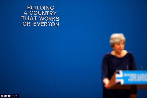 Parts of the conference set also started falling off behind the PM as her speech went from bad to worse