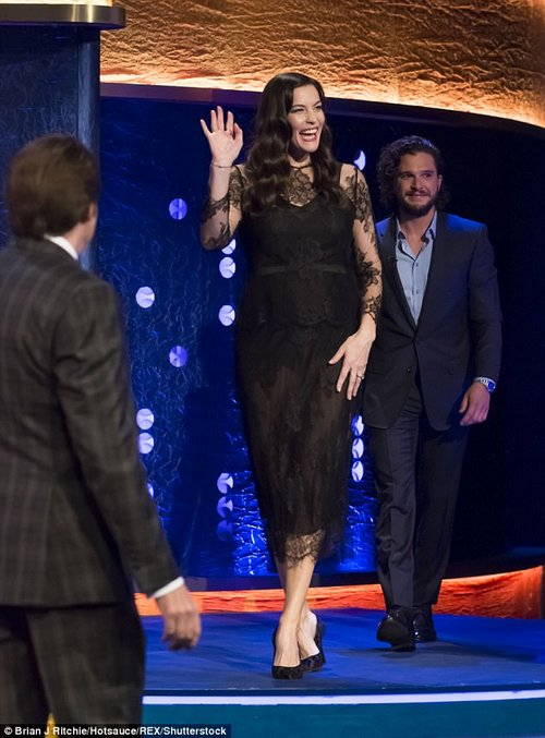 Lovely lace: Liv Tyler, wearing a sophisticated black lace dress and matching heels confessed she felt like 'really bad because I was kinda bitchy' before her fiance, Dave Gardner, proposed
