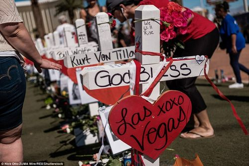 People look at the makeshift memorial which has popped up at the famed ''Welcome to Las Vegas'' sign last week