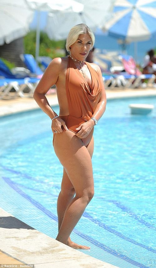 What a figure: The reality star confidently showed off her hourglass figure in defiance of the vile trolls who had reportedly fat-shamed her after she put on a stone in weight