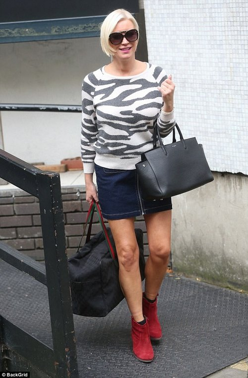 Centre of attention: Denise looked chic for her appearance in a thigh-skimming denim skirt and zebra print jumper