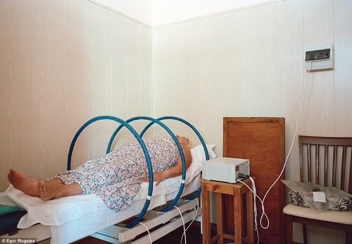 Force for good: A female guest undergoes a form of bizarre-looking magnetic therapy at a sanatorium in Belarus