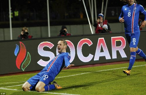 Everton midfielder Sigurdsson celebrates after his goal put Iceland into the lead against Kosovo on Monday night
