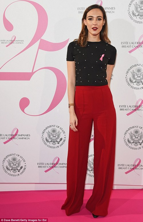 Flare for fashion: Naomi Harris turned heads in striking red flares and a black cropped jumper, adorned with pearls