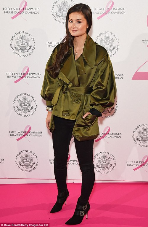 Making them green with envy:Peony Lim slipped into a striking green trench coat and skinny jeans