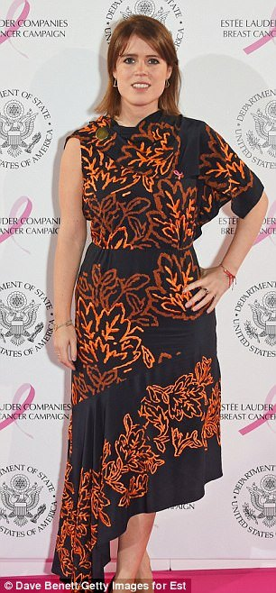 Stylish: The 27-year-old was effortlessly chic in a one-shoulder wrap dress, patterned with orange flowers