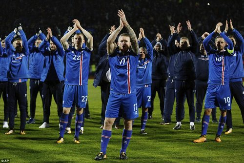 Iceland captain Gunnarsson leads the celebrations after the final whistle on a memorable night inReykjavik
