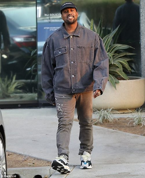 Good mood: The rapper was all smiles as he headed to his car donning a grey denim jacket and hat