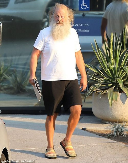 Dressed down: Music legend Rick Rubin sported a wild white beard, along with shorts and a tee shirt
