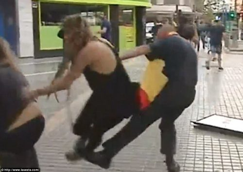 Footage captures the moment a Nazi-saluting thug kicked a woman to the ground during an independence march in Valencia
