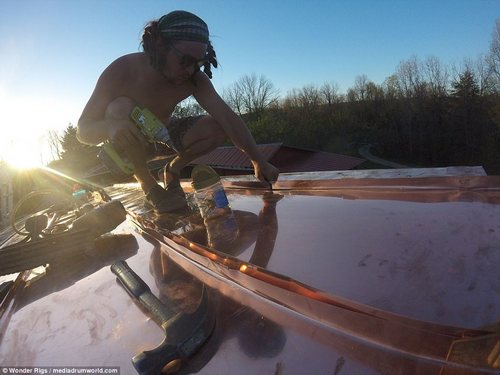 Stevie fixes the roof of his cabin as the sun sets. He said:We had just graduated from university and knew we wanted something more than days jobs and rent'