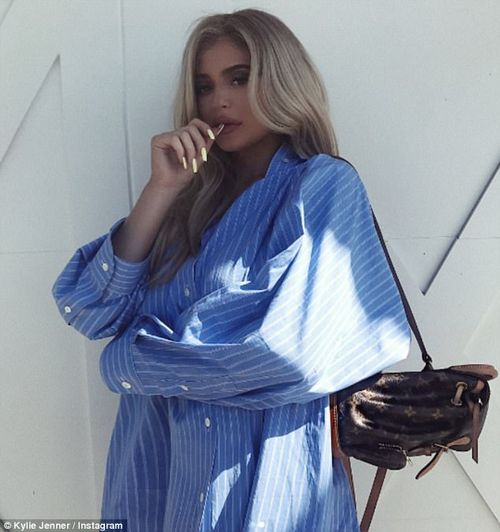 Covered up:To further cement talk of pregnancy the star posted two photos of herself in a massive button down shirt which drowned out any hint of a baby bump