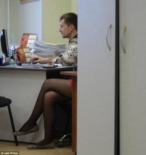 A pair of very feminine legs alter this covertly-snapped shot of an office worker somewhat...