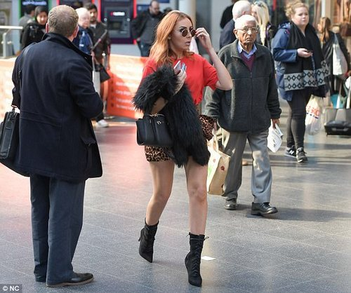 Turning heads! The 29-year-old party girl, whose evening with married father Wayne resulted in him being arrested for drink driving, turned heads in a leopard print mini skirt as she caught a train to Euston, days after Coleen, 31, was pictured without her wedding ring