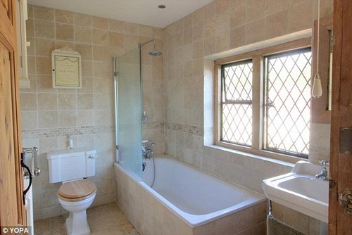 This bathroom is in a two-bedroom semi-detached house in Dorset's Christchurch, which has an asking of £335,000 and is being sold by estate agents Yopa